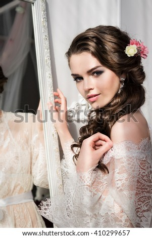 the bride, the bride's hairstyle, the bride's morning, bride in front of the mirror