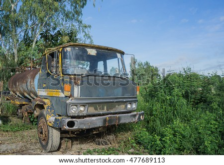 The broken old truck. This truck is abandoned beside of the road. No anyone else owner matter in this picture.