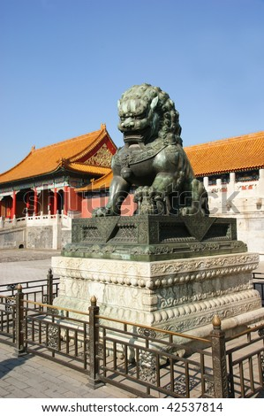 The bronze lion statue on a stone base in the ancient imperial palace in Beijing,China.