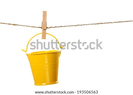 The bucket hanging on the rope isolated on white background