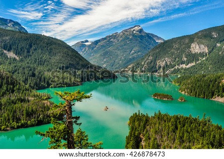 The calm emerald waters of Diablo Lake are framed by mountains in Northern Cascades National Park, Washington.