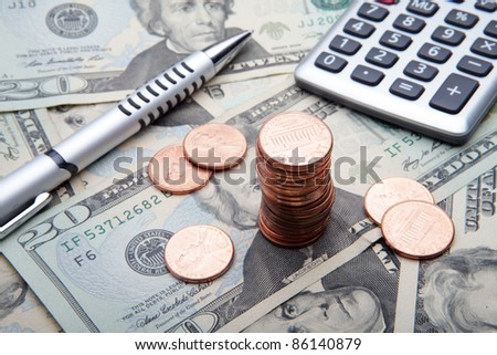 the 1 cent coins on banknotes background