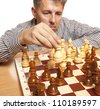 The chess player on a white background - stock photo