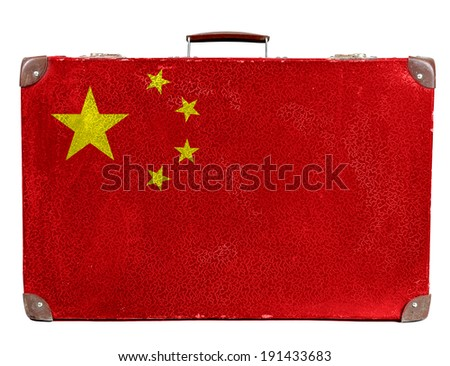 The Chinese flag painted on old grungy travel suitcase or trunk