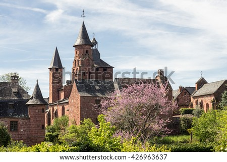 The Church of Saint Pierre in Collonges-la-Rouge - beautiful red village in France. Collonges-la-Rouge is entirely built with red sandstone.