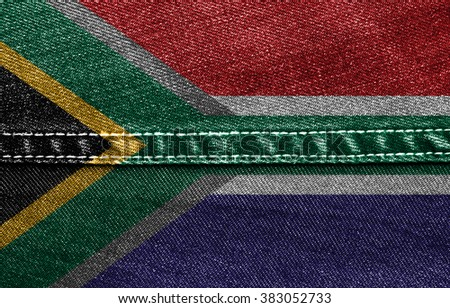 The concept of national flag on jeans denim background: South Africa