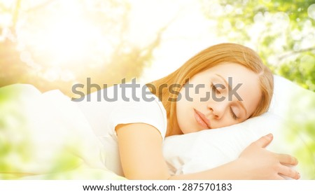 the concept of rest and relaxation. woman sleeping in bed on the background of nature