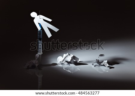 The conceptual image on a theme of narcotic dependence, white reflective background.