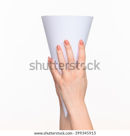 The cone in female hands on white background