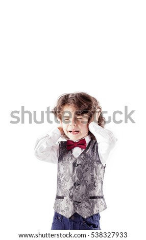 The curly-haired boy in a silver waistcoat crying her eyes closed and ears. White background.