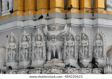 The decoration of high relief statue on the top of ancient Prang in Wat Phra Si Mahathat, Pitsanulok, Thailand