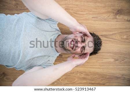 The Depressed Man Lay On The Floor And Keep His Head