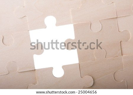 the detail of a missing piece in a puzzle