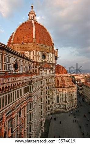 The dome of the Florence Duomo in late afternoon, with a view over town square.