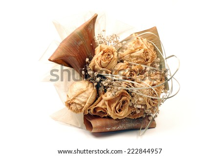 The dried bouquet of roses is on white background.