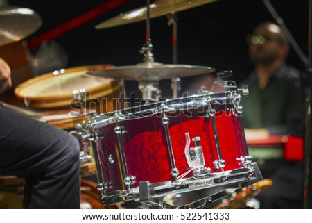 The drummer in action. A photo close up process play on a music
