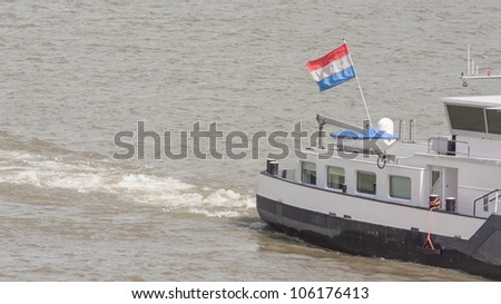 The Dutch national flag on a ship in the harbor of Rotterdam