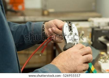 the electrician cuts the wire with special tools to connect