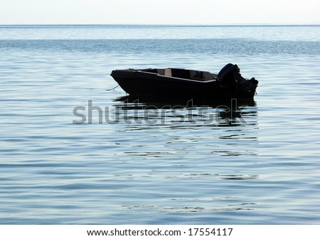 The empty boat in calm waters of Caribbean Sea.