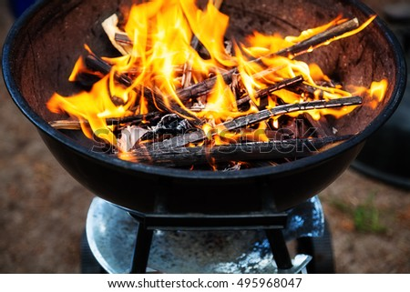 The fire brightly blazing in the grill
