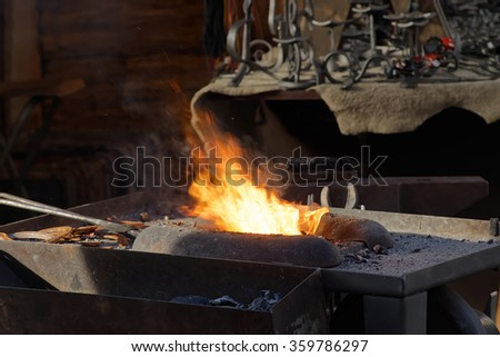 The fire used by the blacksmith in the forge
