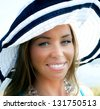 The girl in a hat with a dazzling smile. - stock photo