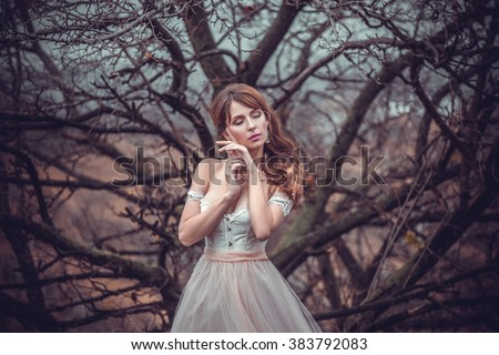 The girl in transparent dress with long flying pastel train stands near the tree , Shabby chic, boho style , fashion creative computer color rendering