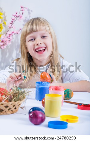 the girl painting easter eggs