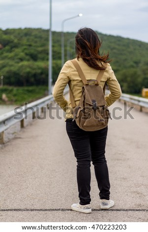 The girl stood out travel bag, The girl stood shoulder bag nature, Women bag on the road