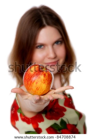 The girl with an apple isolated on the white background