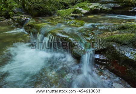 The great rapids of a mountain creek in the magical forest