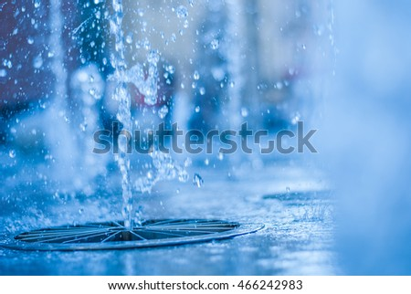 The gush of water of a fountain. Splash of water in the fountain, abstract image.