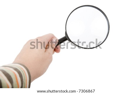 The hand holds a magnifier on isolated white