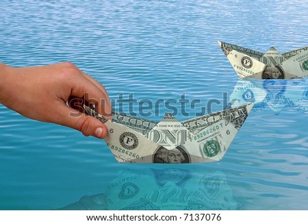 The hand starts ships from paper dollars