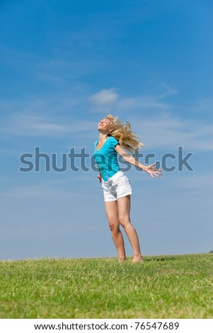 The happy young woman  in the field
