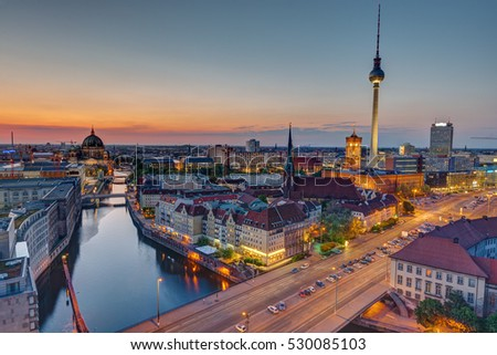 The heart of Berlin with the famous Television Tower after sunset