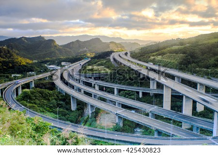 The Highway in night with cars light in modern city in Taiwan, Asia