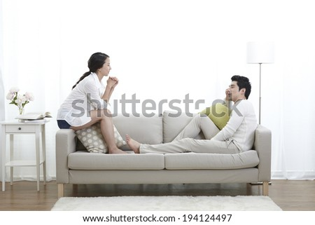 the image of Asian couple on couch