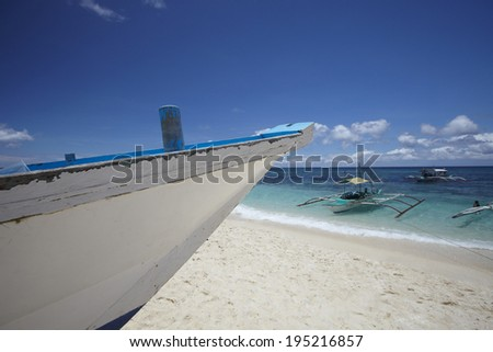 the image of boats on the beach in the Philippines