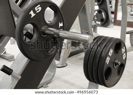 The image of dumbbells on a stand