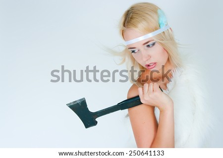 The image of the aggressive blonde with an axe in hands