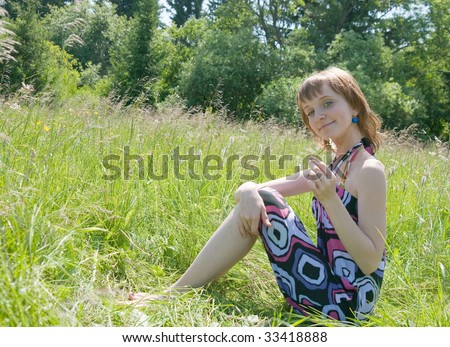 The image of the girl holding a camomile