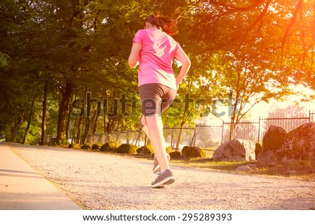 The image with a running woman in a park