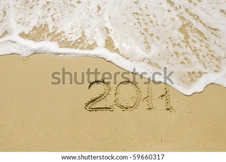 The inscription on the sand - 2011, the new year. Background.
