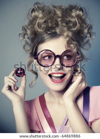 The laughing beautiful girl in pink glasses, a retro style