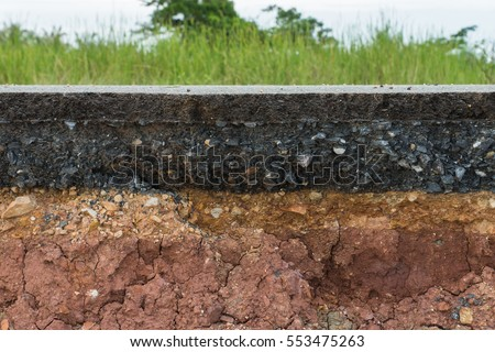 The layer of asphalt road with soil and rock. Un-focus image.
