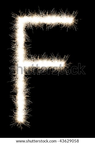 The letter F from a Bengal fire, on a black background, it is isolated.