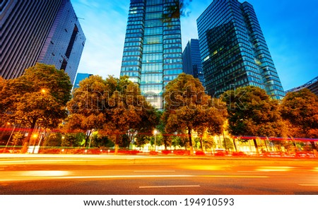 the light trails on the modern building background in hangzhou china.