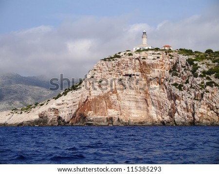 The lighthouse on the entrance of the Skrivena Luka (hidden bay) of the island Lastovo in the Adriatic sea of Croatia