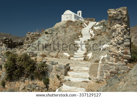 The little white church which stands at the highest point of the town of Serifos island, Greece